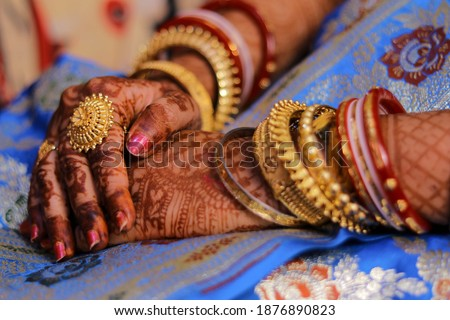 Picture of hands of a new bride who is wearing a beautiful big ring  on her finger. Selective focus concept. Ring is the main subject of this picture and it is focused.