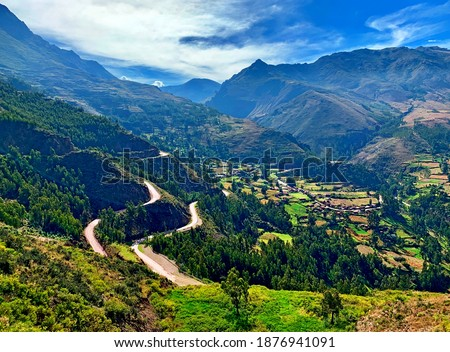 Scenic winding roads to Sacred Valley Incas Urubamba Peru majestic Andes mountains at summer season. Idyllic landscape of South America, spectacular views of beautiful peaceful nature Cuzco region. Royalty-Free Stock Photo #1876941091