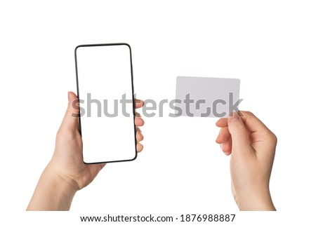 Online payment concept. Pov cropped close up view photo of female hands using blank credit card and smart telephone isolated white background