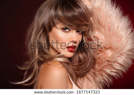 Brunette short hairstyle. Red lips makeup. Beautiful Woman in fur coat. Gorgeous model with short shiny haircut. Concept Coloring Hair. Beauty Salon. Royalty-Free Stock Photo #1877147323