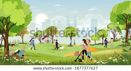 Morning city park with family having fun in the park,boys walking the dog,man talking on phone, women sitting on bench, two guys reading a book under tree,City lifestyle of people in Summer time Royalty-Free Stock Photo #1877377627