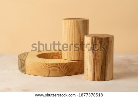 Wooden cylinders and ring on the isometric pastel background.Good as shape geometrical podiums for showing products.