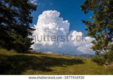 Teruel Spain blue sky with cumulus cloud forming over the mountains. Royalty-Free Stock Photo #1877456920
