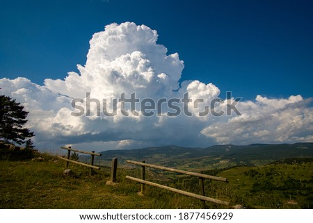 Teruel Spain blue sky with cumulus cloud forming over the mountains. Royalty-Free Stock Photo #1877456929
