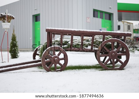 Art object cart outdoors on snow background