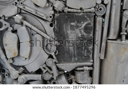 Conceptual photo of gray metal auto parts.