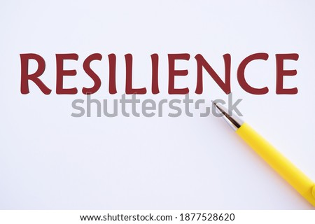 Text sign showing Resilience. Conceptual photo Capacity to recover quickly from difficulties Persistence.yellow pen on white paper , copy space.