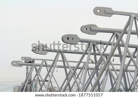 Boom spare part for construction crane, gray metal structures on gray background Stock photo with empty space for text and design.