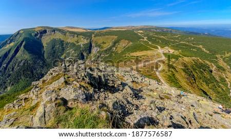 View on the Giant Valley (Obri dul), the Well Mountain (Studnicni hora), the Plain under the Sniezka, Lomniczka Cwm. Giants Mountains ridge (Karkonosze). Polish - Czech border. Royalty-Free Stock Photo #1877576587