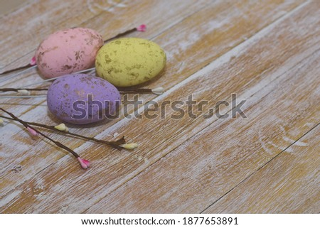 Easter eggs in nest on wooden background. Happy easter.