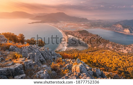 Scenic aerial paniramic view from mountain Bozburun to Iztuzu beach and the Dalyan river Delta as well as lake Sulungur at sunset time. Majestic autumn landscape. Explore natural wonders of Turkey