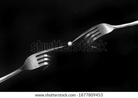 to forks with spark funny picture   concept the creation of adams        Royalty-Free Stock Photo #1877809453