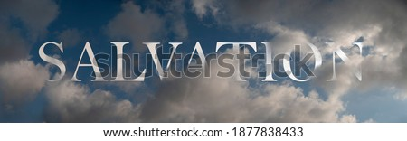 Abstract religious concept. Salvation in the air. Symbolic word inscibed amongst clouds on a dark blue sky. Royalty-Free Stock Photo #1877838433