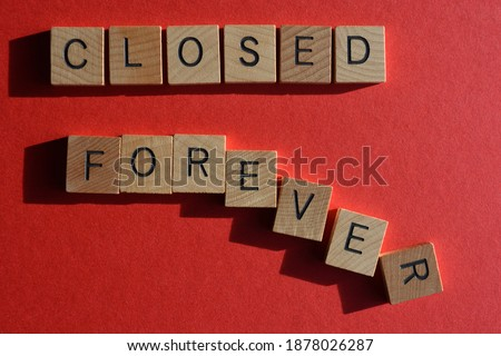 Closed Forever, words in wooden alphabet letters isolated on red background