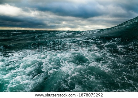 Ocean storm. Storm waves in the open ocean. Not a calm open sea. Royalty-Free Stock Photo #1878075292