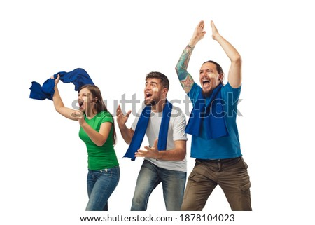 Victory. Three soccer fans woman and men cheering for favourite sport team with bright emotions isolated on white studio background. Looking excited, supporting. Concept of sport, fun, support. Royalty-Free Stock Photo #1878104023