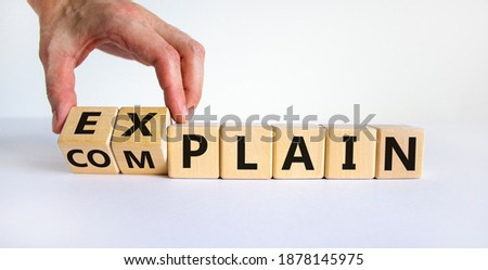 Explain vs complain symbol. Male hand flips wooden cubes and changes the word 'complain' to 'explain'. Beautiful white background, copy space. Business and explain vs complain concept. Royalty-Free Stock Photo #1878145975