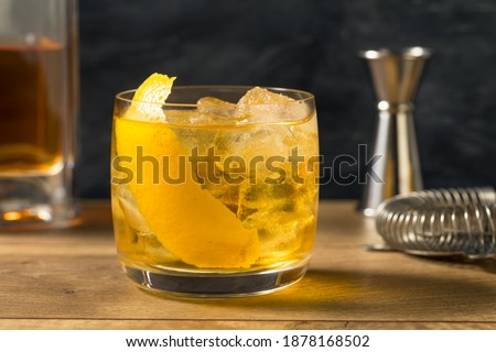 Boozy Refreshing Rusty Nail Cocktail with Lemon Garnish Royalty-Free Stock Photo #1878168502