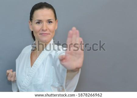 portrait of female karateka posing Royalty-Free Stock Photo #1878266962