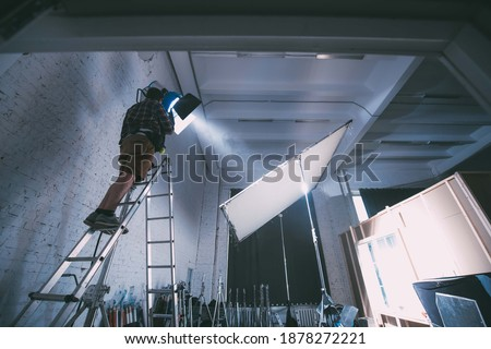 Film set and technology of modern shooting. Film crew, lighting devices, monitors, playbacks - filming equipment and a team of specialists in filming movies, advertising and TV series Royalty-Free Stock Photo #1878272221
