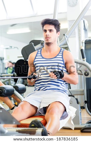 Handsome young man working out at the gym #187836185