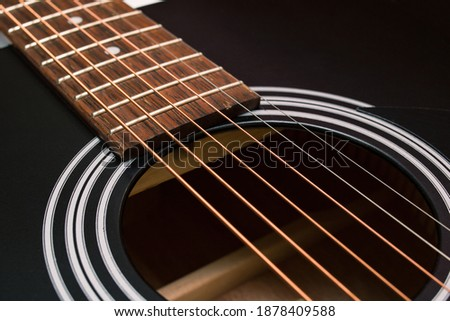 Black and yellow guitar strings closeup macro photography Royalty-Free Stock Photo #1878409588