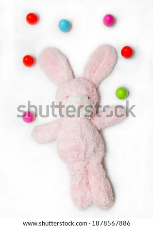Easter pink bunny with colorful eggs on a white background. For wallpaper, postcards and backgrounds.