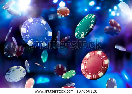Poker Chips falling with dramatic lighting Royalty-Free Stock Photo #187860128