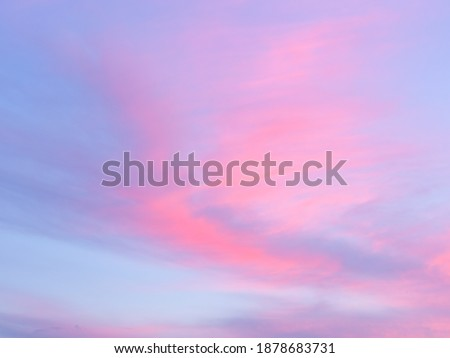 Soft, fluffy and colorful cloud formation. Abstract idyllic pink and blue sky. Blur background texture of colorful sunset clouds. Twilight sky. Fresh air, weather concept Royalty-Free Stock Photo #1878683731