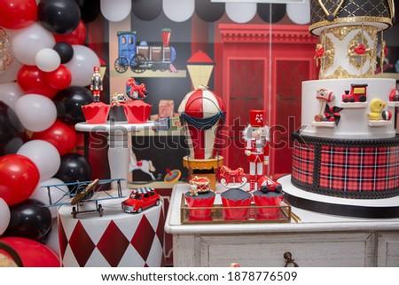 toyshop theme birthday party red and black  Royalty-Free Stock Photo #1878776509