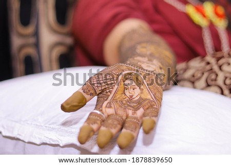 Picture of Bride Mehndi for wedding ceremony. Henna Mehndi on Bride's hand at Indian wedding ceremony. Picture of mehndi hands close up. Beautiful mehndi on Woman's hands. Selective focus concept.