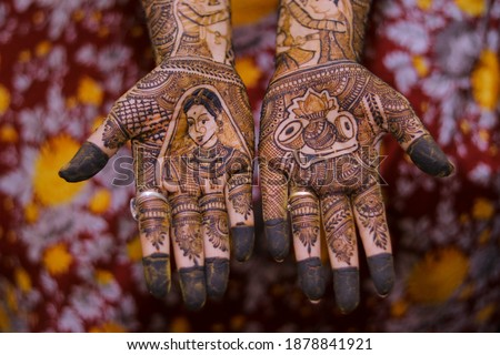 Picture of Bride Mehndi for wedding ceremony. Henna on Bride's hands. Music instruments and bride mehndi design. Picture of mehndi hands close up.  Selective focus concept.