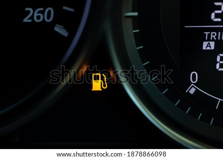 Empty fuel warning light in car dashboard. Fuel pump icon. gasoline gauge dash board in car with digital warning sign of run out of fuel turn on. Low level of fuel show on speedometer dashboard. Royalty-Free Stock Photo #1878866098