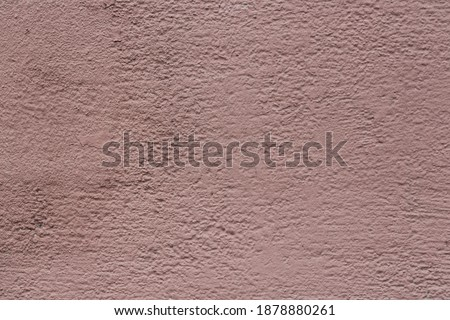 Texture of an old painted wall. Rough surface of the plastered and colored wall. Perfect for background and design. Closeup.