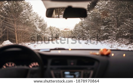 view of the winter road in the forest from the car. winter in Iceland. Winter beautiful pictures of nature in the mountains and forest. Christmas holidays in the north