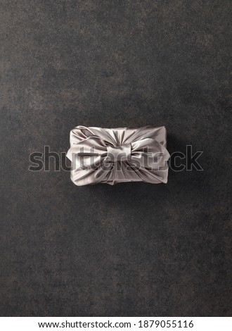 Korean traditional gift packaging cloth made of silk(bojagi) and ornaments with copy space. Isolated on white background Royalty-Free Stock Photo #1879055116