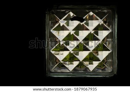 A glass block mosaic background.