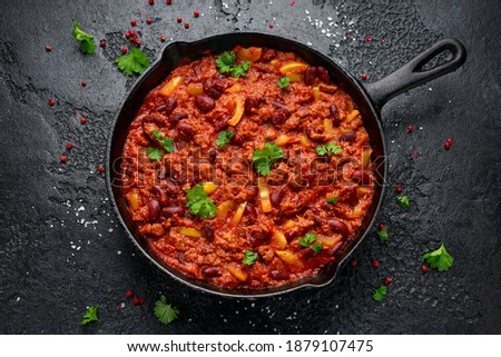 Vegetarian vegan mince chili con carne served in cast iron skillet pan Royalty-Free Stock Photo #1879107475