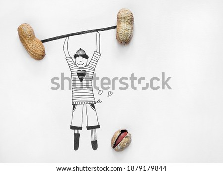 An illustration of a boy lifting dumbbells from real peanuts