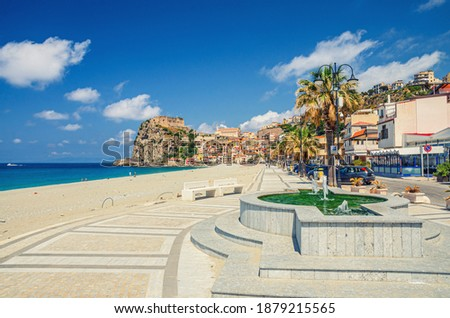 Cityscape of Scilla town with embankment promenade of Mediterranean Tyrrhenian sea coast, old medieval castle Castello Ruffo on rock and colorful traditional italian houses, Calabria, Southern Italy Royalty-Free Stock Photo #1879215565