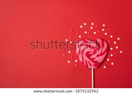 Happy Valentines day concept. Overhead above close up view photo picture of yummy lollypop with sugar topping isolated vivid color red background with blank empty space