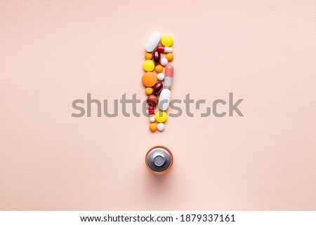 medicine assorted pills exclamation sign isolated over pink background. medical warning symbol. medical solution concept. Royalty-Free Stock Photo #1879337161