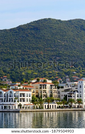 "Pine embankment. Embankment and port ""Porto Montenegro"". Tivat. Montenegro. Lustica Bay is a mini city with a yacht marina. Buildings on the embankment of the city of Tivat.  Royalty-Free Stock Photo #1879504903"