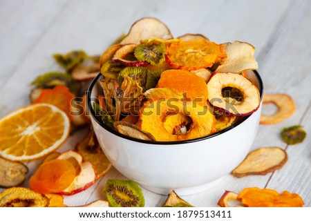Organic Healthy Assorted Dried Fruit Mix close up. Dried fruit snacks. dried apples, mango, feijoa, dried apricots, prunes top view Royalty-Free Stock Photo #1879513411