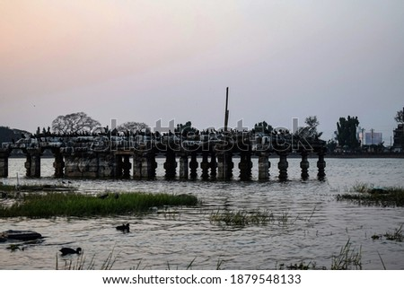 Picture of beautiful sunset in rankala lake in kolhapur city. there is an ancient temple under water this temple konown as Sandhyamath.
