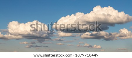 Scenic beautiful wide fantasy dream cloudscape panoramic landscape of beautiful evening or morning blue sky background. Fluffy cumulus cloud floating in clear skyline horizon. Natural sky panorama Royalty-Free Stock Photo #1879718449
