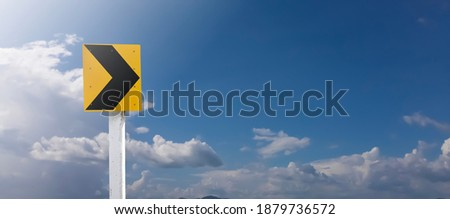 Traffic sign: rign arrow sign on pole with clouds and bluesky background.