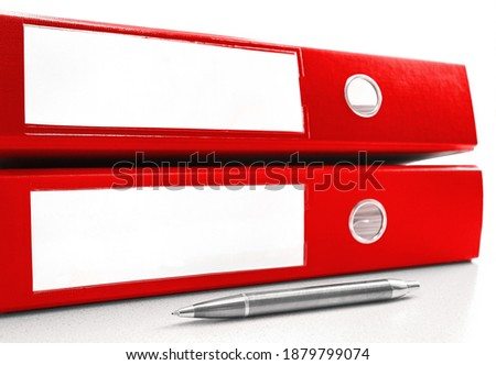two red ring binder on a table Royalty-Free Stock Photo #1879799074