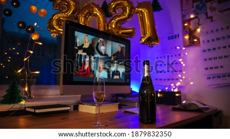 Celebrating Virtual Christmas New Year's Eve party 2021 at home during Covid-19 pandemic. Couple holding and toasting champagne glasses How to celebrate and decorate foiled balloons of 2021. #1879832350
