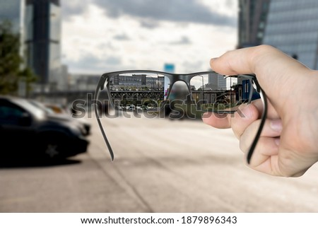 optical eyevision concept, frame of eyeglasses show focused image on the blurred background